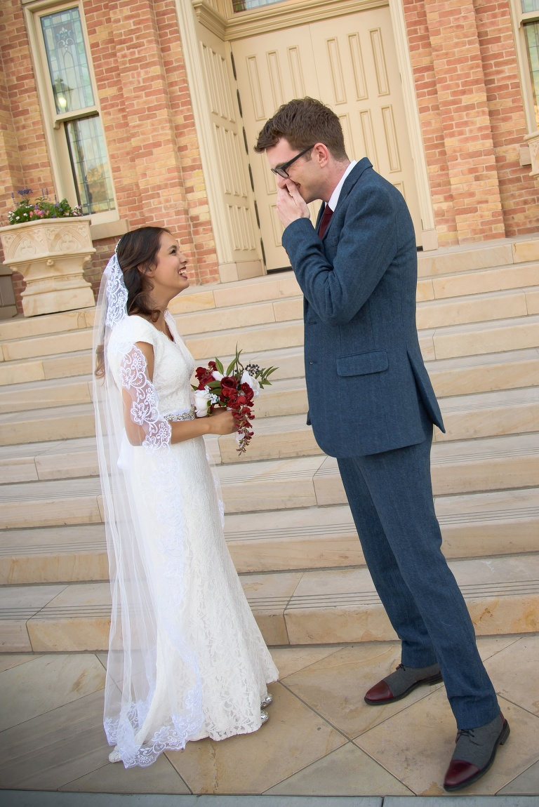 Grooms sees his bride for the first time during their first look formal session at the provo City Center temple