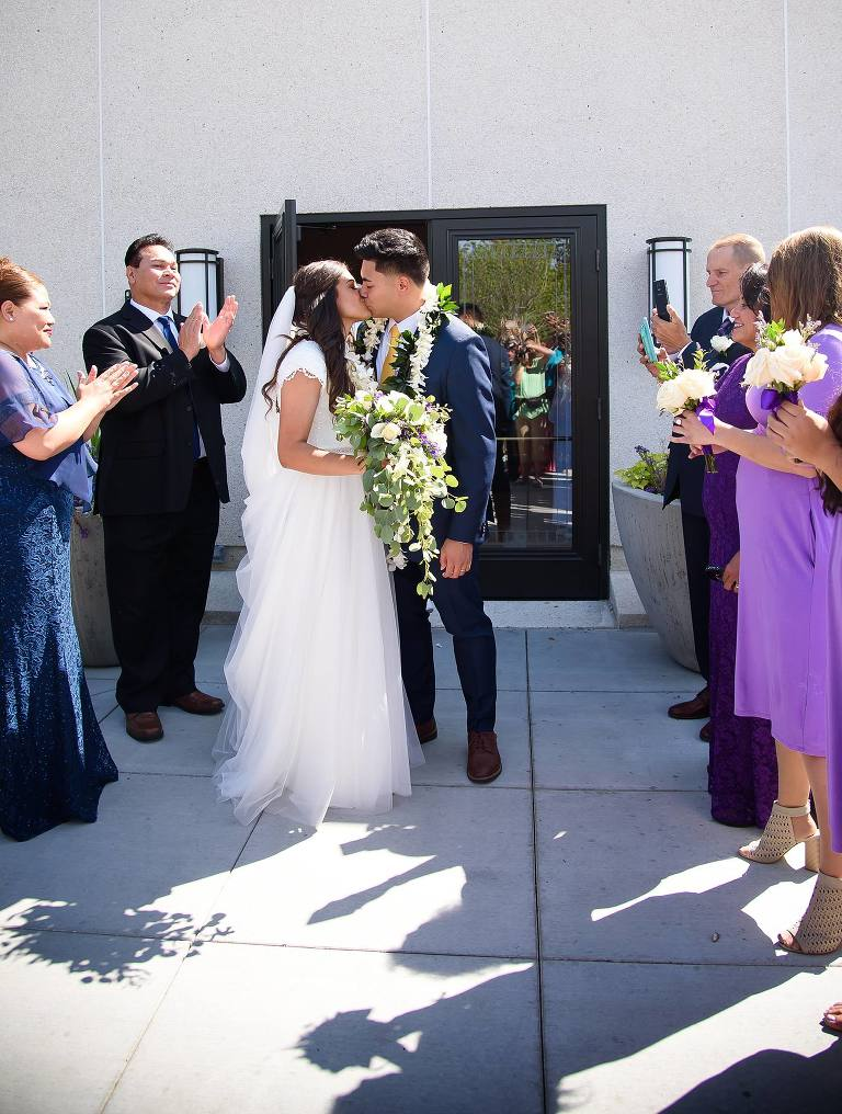 Newlywed couple exits the Jordan River Utah Temple